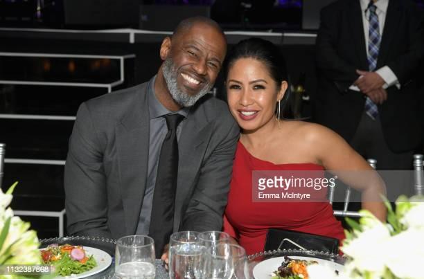 Brian McKnight and Leilani Malia Mendoza attend Celebrity Fight Night XXV on March 23 2019 in Phoenix Arizona