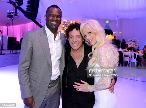 Brian McKnight Neal Schon and Michaele Schon attend the wedding of Michaele Schon and Neal Schon at the Palace of Fine Arts on December 15 2013 in...