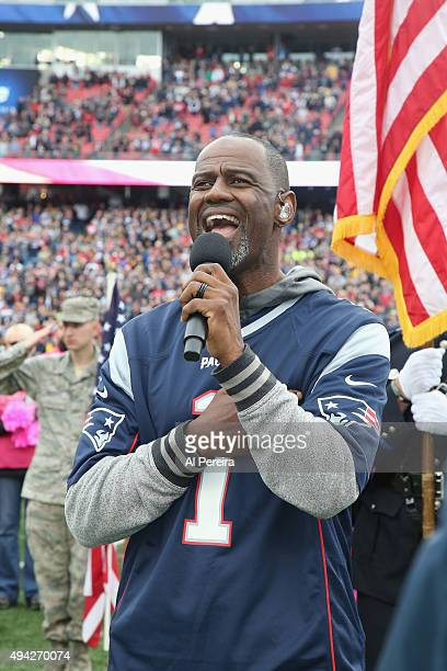 Brian McKnight performs the National Anthem before the New York Jets vs New England Patriots game at Gillette Stadium on October 25 2015 in Foxboro...