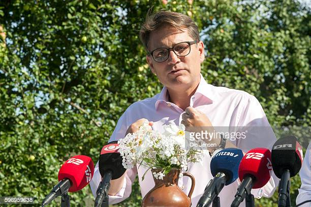 Brian Mikkelsen speaks during the Conservative Party's press briefing following the party's parliamentary group summer meeting in a private garden on...