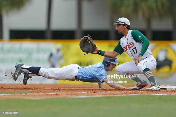 Brian Miller of the North Carolina Tar Heels gets back to first base safe ahead of the ball reaching Christopher Barr of the Miami Hurricanes on...