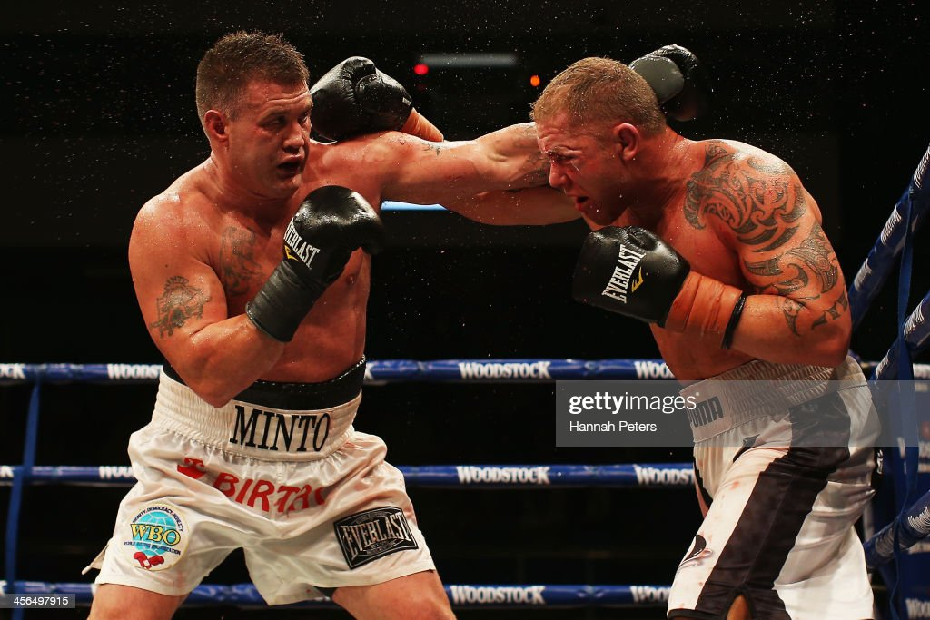 Brian Minto of the USA fights Shane Cameron of New Zealand during 'Fight for Life' at The Trusts Stadium on December 14, 2013 in Auckland, New Zealand.