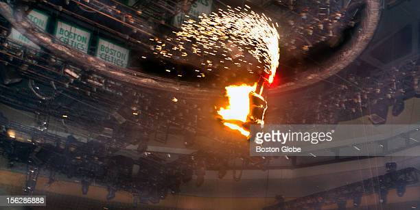 Brian Miser The Human Fuse launched from a self made crossbow arcs across the TD Garden floor while on fire at the Ringling Brothers and Barnum...