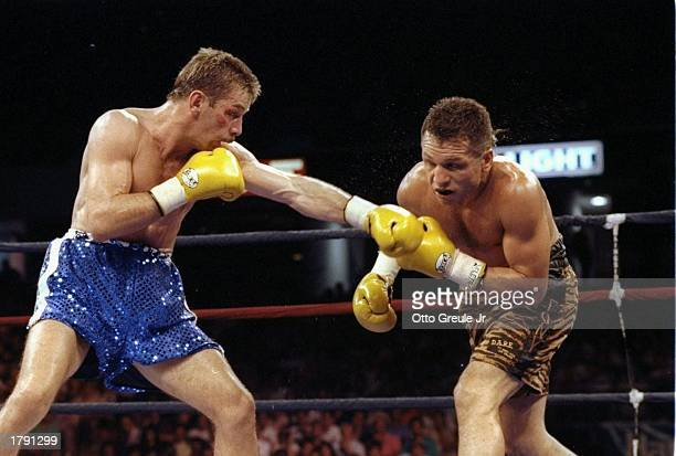 Brian Mitchell and Tony Lopez in action during a bout Mandatory Credit Otto Greule /Allsport