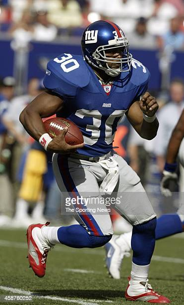 Brian Mitchell of the New York Giants runs with the ball during a game against the St Louis Rams on September 07 2003 at Giants Stadium in East...