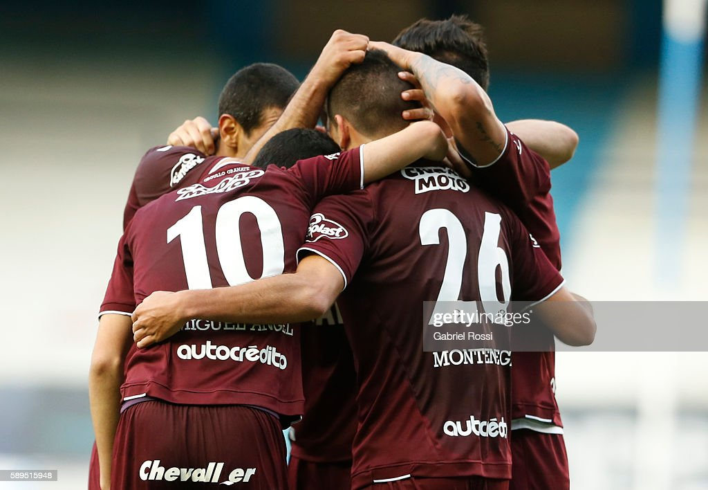 Brian Montenegro of Lanus celebrates with teammates after scoring the first goal of his team during a match between Racing Club and Lanus as part of Copa del Bicentenario de la Independencia 2016 at Presidente Peron Stadium on August 14, 2016 in Avellaneda, Argentina.