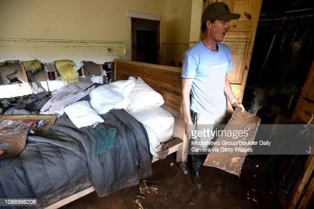 Brian Montgomery works to clean up the mud in his mothers flooded basement on Saturday Sept 14 on Olde Stage Road in Boulder For more photos and...