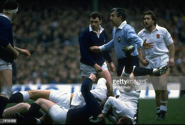 Brian Moore of England takes a tumble after another decision by the French referee during the Five Nations Championship match against Scotland at...