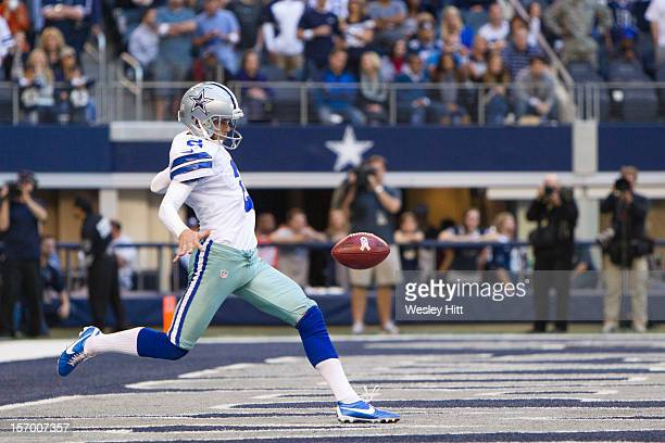 Brian Moorman of the Dallas Cowboys punts the ball from the end zone during a game against the Cleveland Browns at Cowboys Stadium on November 18...