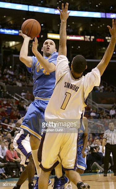 Brian Morrison of the UCLA Bruins shoots over Tre Simmons of the Washington Huskies during the quarterfinals of the 2004 Pacific Life Pac10...