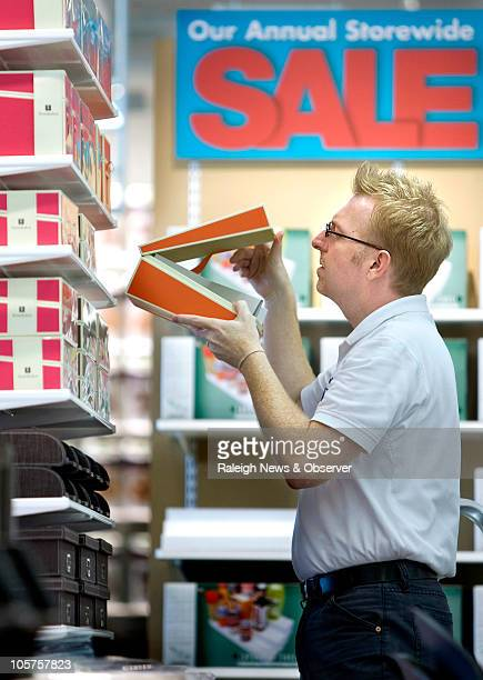 Brian Morrison senior merchandise director puts finishing touches on a display in the new Container Store in Raleigh North Carolina