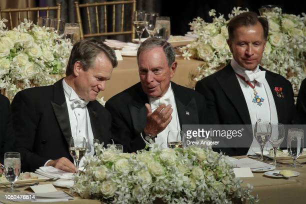 Brian Moynihan CEO of Bank of America speaks with former New York City Mayor Michael Bloomberg during at the annual Alfred E Smith Memorial...