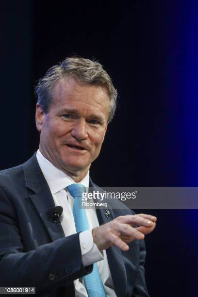 Brian Moynihan chief executive officer of Bank of America Corp gestures as he speaks during a panel session on the opening day of the World Economic...