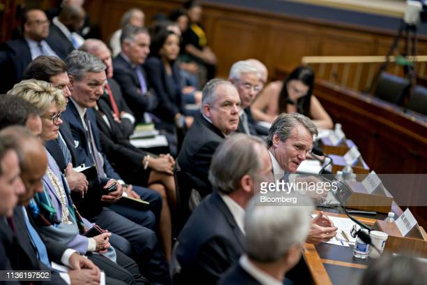 Brian Moynihan chief executive officer of Bank of America Corp center right speaks during a House Financial Services Committee hearing in Washington...