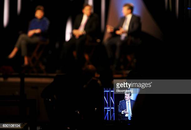 Brian Moynihan chief executive officer of Bank of America Corp is seen on a monitor while speaking during the Charlotte Chamber's Outlook Event in...