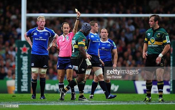 Brian Mujati of Northampton is shown a yellow card by Referee Romain Poite during the Heineken Cup Final between Leinster and Northampton Saints at...