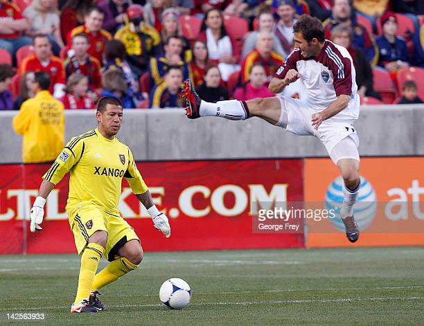 Brian Mullan of Colorado Rapids tries to disrupt the kick of goalie Nick Rimando of Real Salt Lake during the first half of an MLS soccer game April...