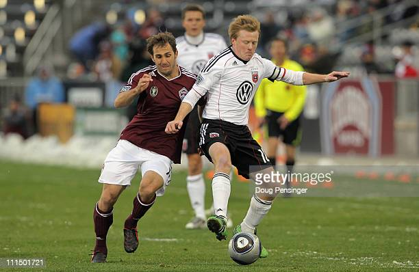Brian Mullan of the Colorado Rapids and Dax McCarty of D.C. United battle for control of the ball at Dick's Sporting Goods Park on April 3, 2011 in...