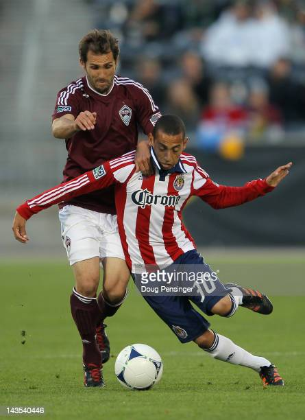 Brian Mullan of the Colorado Rapids and Paolo Cardozo of Chivas USA battle for control of the ball at Dick's Sporting Goods Park on April 28 2012 in...