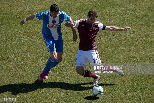 Brian Mullan of the Colorado Rapids battles for the ball with Sebastien Le Toux of the Philadelphia Union during the first half at Dick's Sporting...