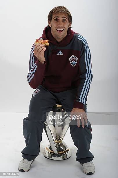 Brian Mullan of the Colorado Rapids poses with the Philip F Anschutz MLS Cup trophy following the MLS Cup final at BMO Field on November 21 2010 in...
