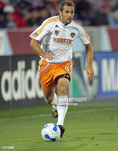 Brian Mullan of the Houston Dynamo controls the ball against the Colorado Rapids at Dick's Sporting Goods Park on May 5 2007 in Commerce City Colorado