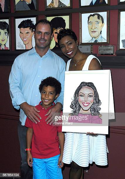 Brian Musso Heather Headley and John David Musso appear to unveil her caricature at Sardi's on August 9 2016 in New York City