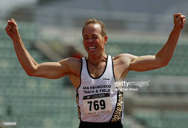 Brian Mutert of San Fransisco shows his delight after winning the Men's 45 years 400 metre hurdles during the 2002 Sydney Gay Games at the Homebush...