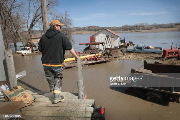 CRAIG MISSOURI MARCH 22 Brian Nutchler looks out over his flooded property on March 22 2019 in Craig Missouri Midwest states are battling some of the...