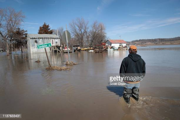 CRAIG MISSOURI MARCH 22 Brian Nutchler walks through floodwater to his home on March 22 2019 in Craig Missouri Midwest states are battling some of...