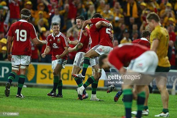 Brian O'Driscoll and Alex Cuthbert of the Lions celebrate victory during the First Test match between the Australian Wallabies and the British &...