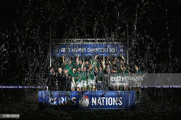 Brian O'Driscoll and captain Paul O'Connell of Ireland celebrate with their team-mates as they lift the trophy after winning the six nations...