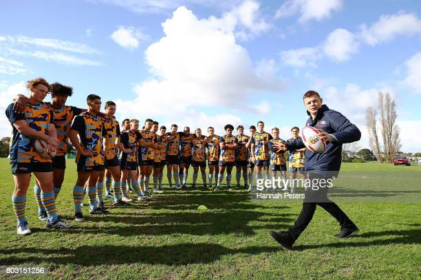 Brian O'Driscoll and Justin Marshall attend a Land Rover coaching session with Mt Albert Grammar school during a British Irish Lions Fan Day on June...