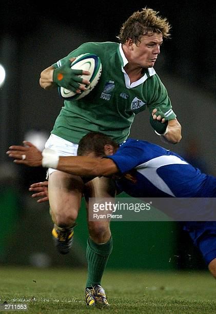 Brian O'Driscoll for Ireland is tackled during the Rugby World Cup Quarter Final between France and Ireland at Telstra Dome November 9, 2003 in...