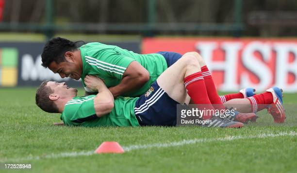 Brian O'Driscoll, looks dejected after being dropped by the Lions for the third and final test against the Wallabies wrestles with team mate Manu...