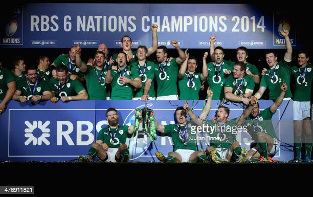 Brian O'Driscoll of Ireland and team mates celebrate with the Six Nations Championship trophy during the RBS Six Nations match between France and...