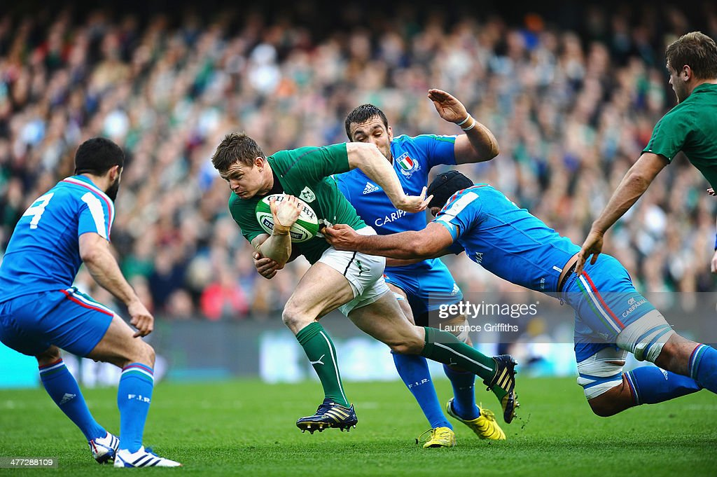 Brian O'Driscoll of Ireland breaks away during the RBS Six Nations match between Ireland and Italy at Aviva Stadium on March 8, 2014 in Dublin, Ireland.