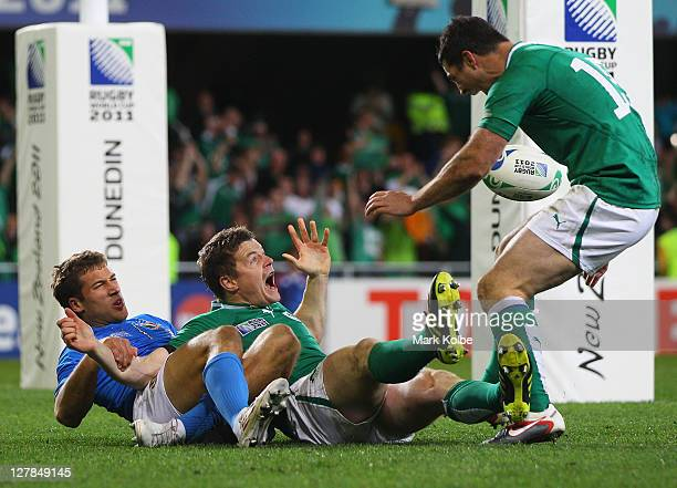 Brian O'Driscoll of Ireland celebrates scoring a try during the IRB Rugby World Cup Pool C match between Ireland and Italy at Dunedin Stadium on...