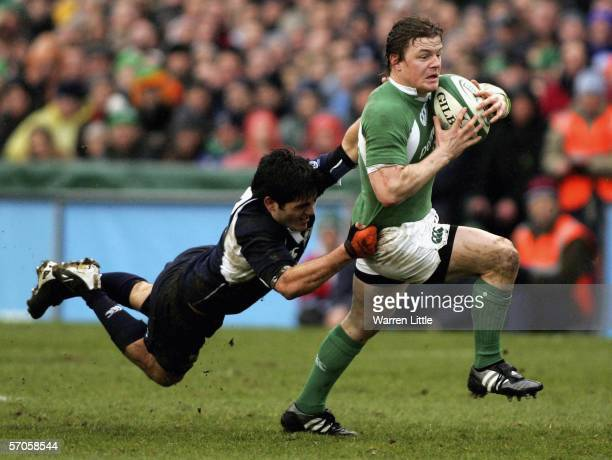 Brian O'Driscoll of Ireland evades Marcus Di Rollo of Scotland during the RBS Six Nations match between Ireland and Scotland at the Lansdowne Road on...