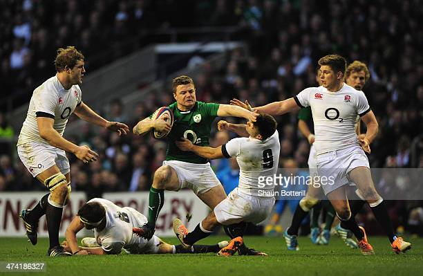 Brian O'Driscoll of Ireland hands off Danny Care of England during the RBS Six Nations match between England and Ireland at Twickenham Stadium on...