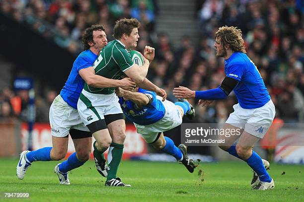 Brian O'Driscoll of Ireland is tackled by Mauro Bergamasco , Andrea Masi and Mirco Bergamasco of Italy during the RBS 6 Nations Championship match...
