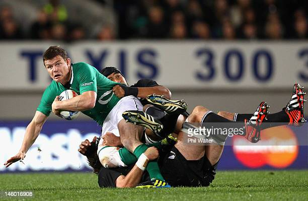 Brian O'Driscoll of Ireland is tackled by Victor Vito of the All Blacks during the International Test Match between the New Zealand All Blacks and...