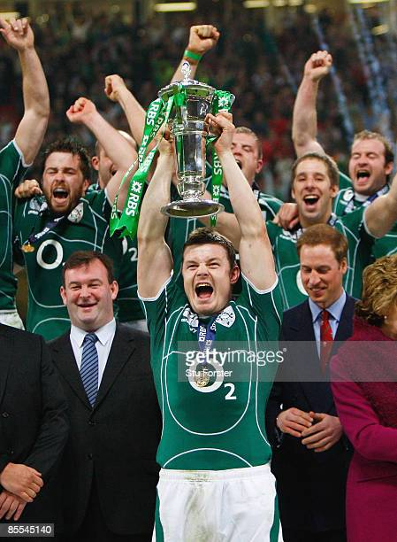 Brian O'Driscoll of Ireland lifts the trophy after Ireland won the Grand Slam as Prince William looks on during the RBS 6 Nations Championship match...