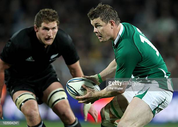 Brian O'Driscoll of Ireland looks for support under pressure from Kieran Read of the All Blacks during the International rugby test match between the...