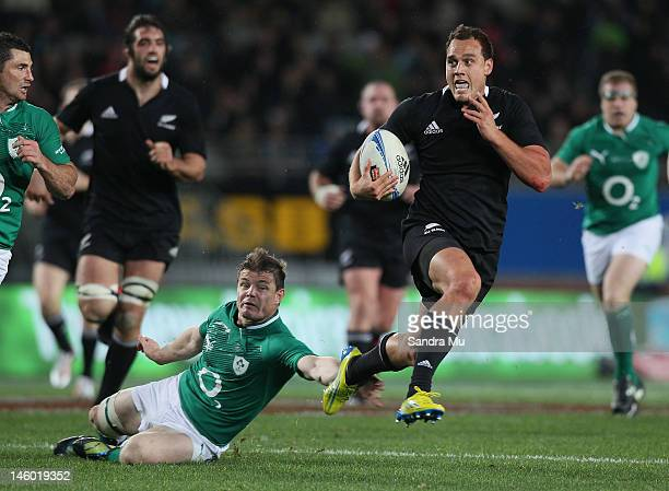 Brian O'Driscoll of Ireland misses the tackle of Israel Dagg of the All Blacks during the International Test Match between the New Zealand All Blacks...