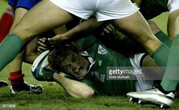 Brian O'Driscoll of Ireland protects himself after releasing the ball during the Rugby World Cup Quarter Final 3 match between France and Ireland at...