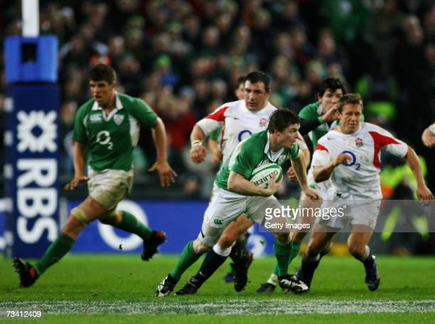 Brian O'Driscoll of Ireland runs with the ball during the RBS Six Nations Championship match between Ireland and England at Croke Park on February 24...