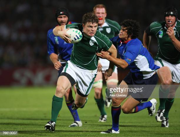 Brian O'Driscoll of Ireland surges away from the challenge of Tertius Losper of Namibia during Match Eight of the Rugby World Cup 2007 between...