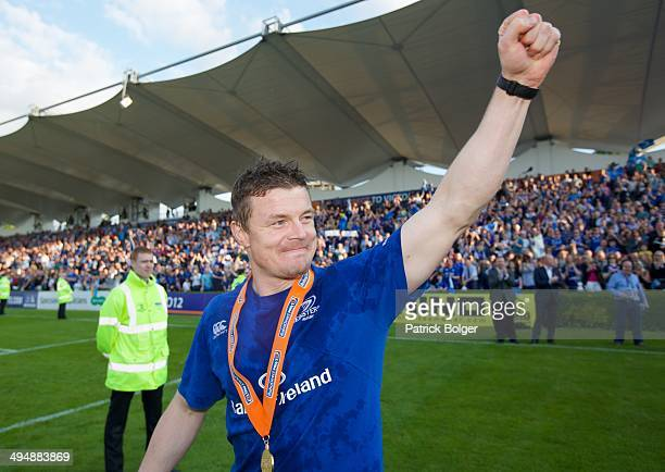 Brian O'Driscoll of Leinster gestures to fans in the last match of his career after winning the Pro 12 trophy after victory against Glasgow during...