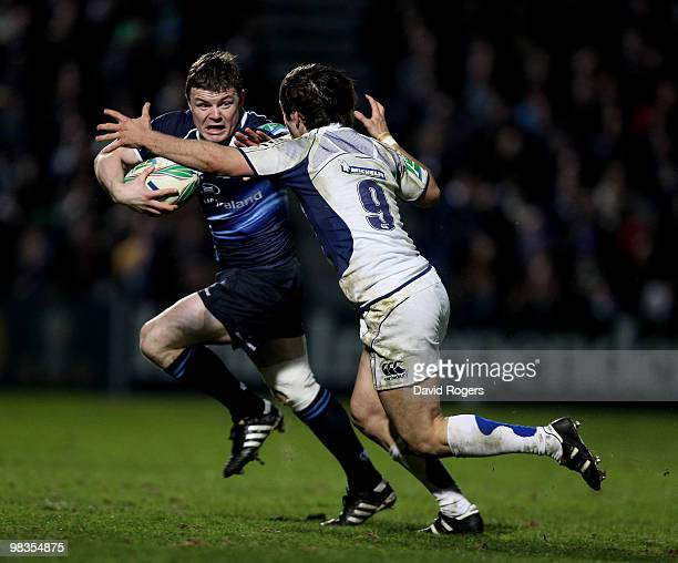 Brian O'Driscoll of Leinster holds off Morgan Parra during the Heinken Cup quarter final match between Leinster and Clermont Auvergne at the RDS on...